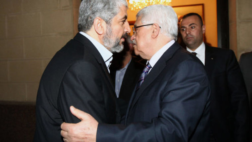 Hamas leader Khaled Mashaal (left) meets with Palestinian Authority President Mahmoud Abbas in Cairo, Feb. 23, 2012. Credit: Mohammed al-Hums/Flash 90.