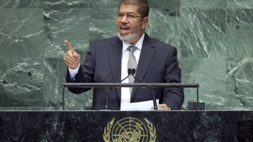 Click photo to download. Caption: Egyptian President Mohamed Morsi, seen speaking to the United Nations General Assembly, on Sept. 26, 2012, is overseeing a country with growing religious violence, particularly against Coptic Christians. Credit: UN Photo/Marco Castro.