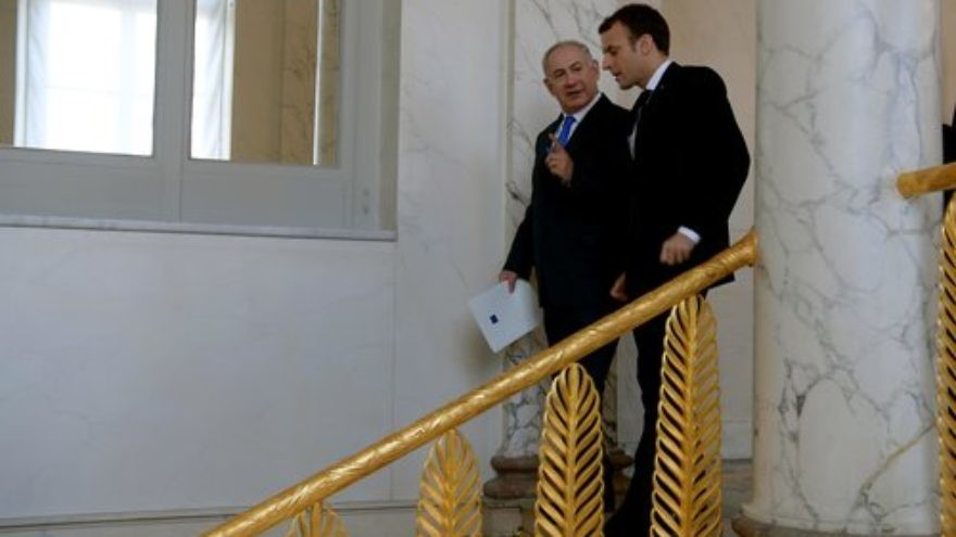 Israeli Prime Minister Benjamin Netanyahu and French President Emmanuel Macron meet on Dec. 10 at the Elysee Palace in Paris. Credit: Avi Ohayon/GPO.