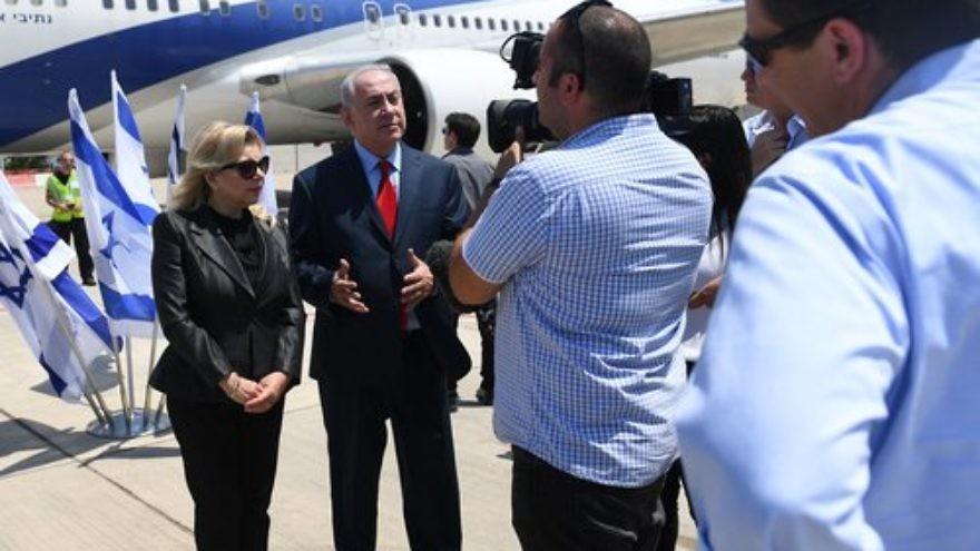 Israeli Prime Minister Benjamin Netanyahu, alongside his wife Sara, gives remarks before boarding a plane June 30, 2017. Credit: Kobi Gideon/GPO