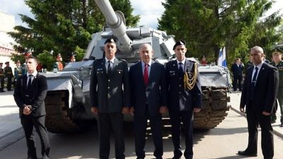 Israeli Prime Minister Benjamin Netanyahu (center) visits an armory museum in the Russian capital of Moscow June 8, 2016. The museum housed an Israeli tank captured by the Syrian army during the First Lebanon War's battle of Sultan Yacoub, but following a request by Netanyahu, Russian President Vladimir Putin agreed to return the tank to Israel. Credit: Haim Zach/GPO.