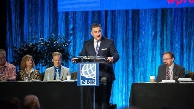 "National Religious Broadcasters (NRB) President Dr. Jerry Johnson (at podium) speaks at the organization's International Christian Media Convention Feb. 27 in Orlando, Fla. Johnson said that the ""DNA of NRB is pro-Israel, because it is a biblical DNA."" Credit: NRB via Facebook."