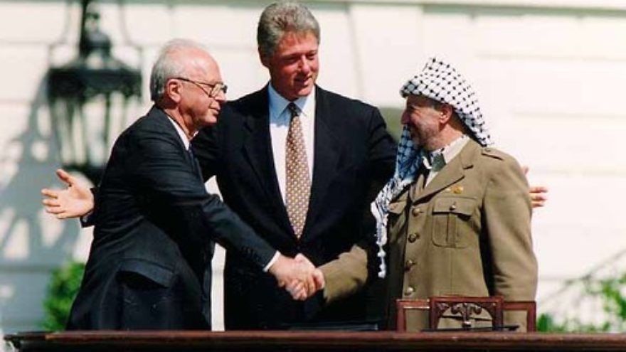 "Click photo to download. Caption: Yitzhak Rabin, Bill Clinton, and Yasser Arafat at the signing of the Oslo Accords on Sept. 13, 1993. In an op-ed for JNS.org, Israeli Deputy Defense Minister Danny Danon wrote of renewed Israeli-Palestinian conflict negotiations, ""Almost 20 years after Yitzhak Rabin attempted to conjure arch-terrorist Yasser Arafat into a worthy partner for peace, it seems that we have not learned the lessons from the past."" Credit: Vince Musi/The White House."
