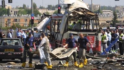 Paramedics and police at the scene of a Palestinian suicide bombing, killing 19 and injuring 74, on a bus in Jerusalem on June 18, 2002. Credit: Flash90