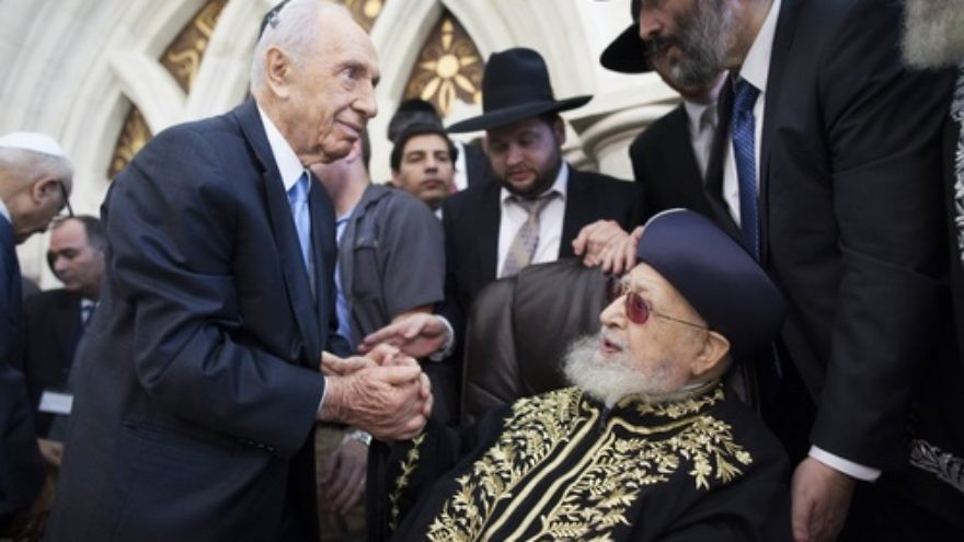 Click photo to download. Caption: Shas spiritual leader Rabbi Ovadia Yosef shakes hands with Israeli President Shimon Peres at a Sept. 16 ceremony at the Rabban Yohanan Ben Zakai Synagogue in Jerusalem during which his son, Rabbi Yitzhak Yosef, officially became the Sephardi Chief Rabbi of Israel. Photo by Yonatan Sindel/Flash90.