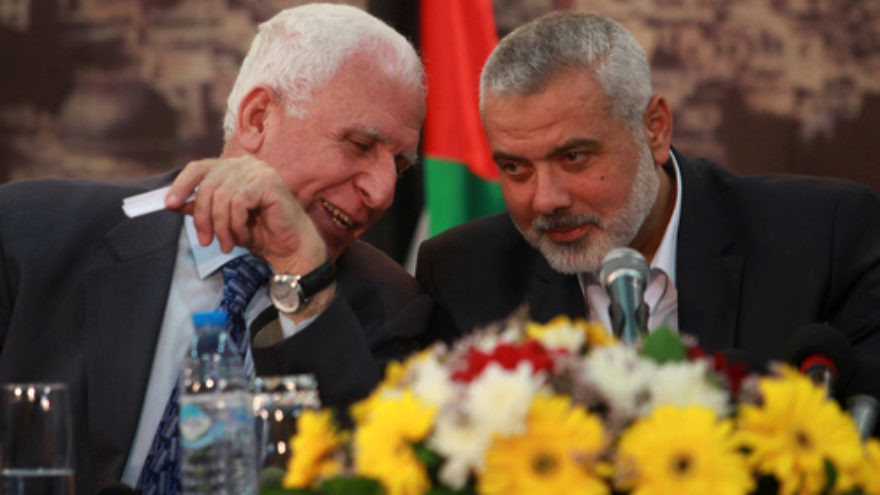 File photo: Head of the Hamas government Ismail Haniyeh (right) and senior Fatah official Azzam Al-Ahmed at a news conference in Gaza City. Credit: Abed Rahim Khatib/Flash90.