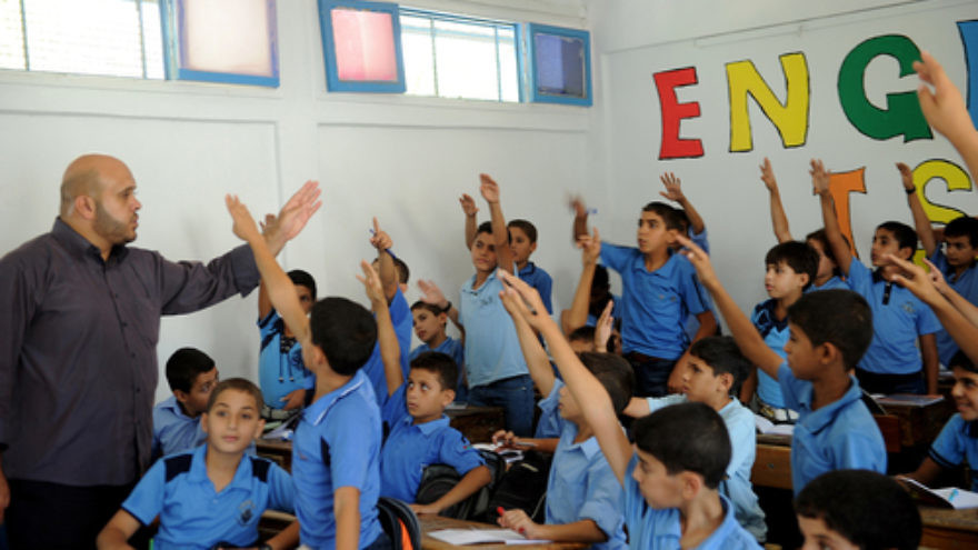 Click photo to download. Caption: In September 2011, Palestinian boys raise their hands during one of the first classes of the new academic year at a school in Gaza supported by the United Nations Relief and Works Agency for Palestine Refugees in the Near East (UNRWA). Credit: UN Photo/Shareef Sarhan.