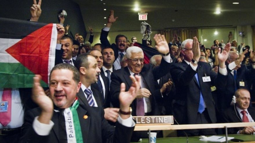 Caption: Members of the Palestinian delegation at the United Nations General Assembly celebrate on Nov. 29, 2012, upon the vote to upgrade Palestinian status to a nonmember observer state in the U.N. The Palestinians may renew their campaign for full U.N. membership, which they froze for the current Israeli-Palestinian conflict negotiations, if the negotiations fail. Credit: UN Photo/Rick Bajornas.