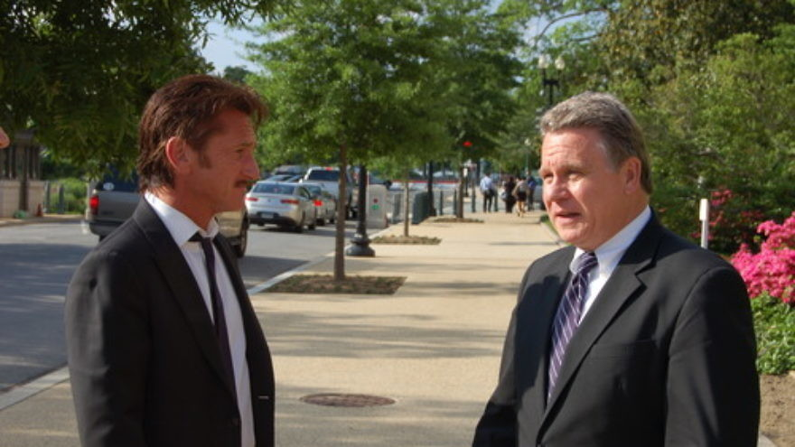 Click photo to download. Caption: Actor Sean Penn (left) with U.S. Rep. Chris Smith (R-NJ) after Penn testified on the case of Jewish prisoner Jacob Ostreicher at a May 20, 2013 congressional hearing organized by Smith. Credit: Office of U.S. Rep. Chris Smith.