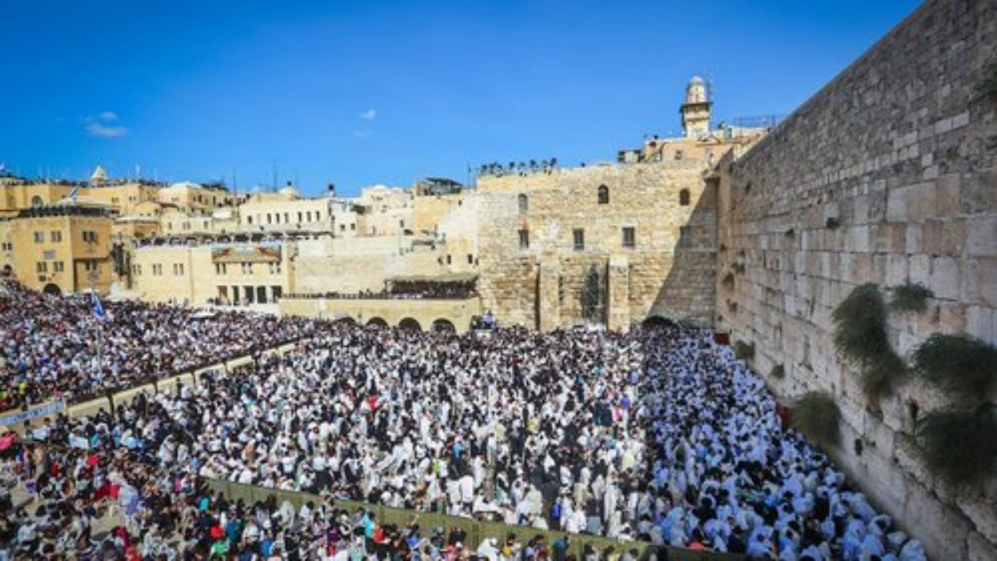 """Jewish worshippers pack the area in front of Jerusalem's Western Wall for the """"Birkat Kohanim,"""" or """"Priestly Blessing,"""" during the holiday of Sukkot on Oct. 8, 2017. Credit: Yaakov Lederman/Flash90."""