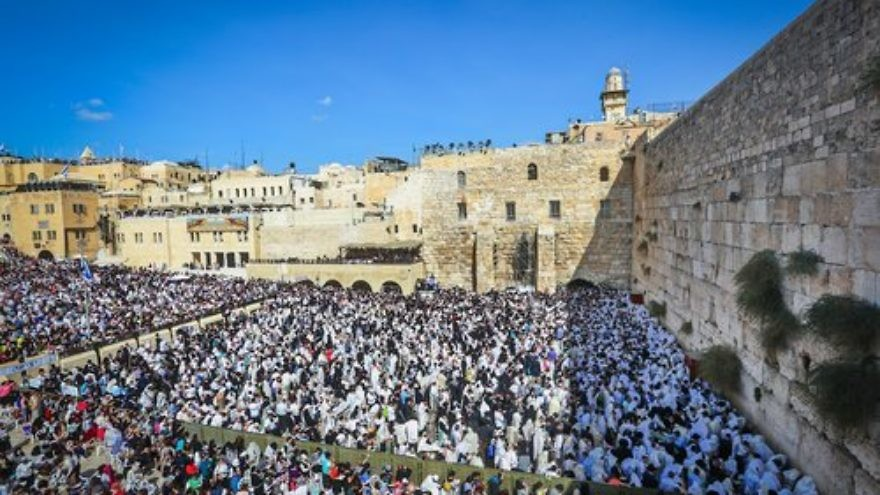 "Jewish worshippers pack the area in front of Jerusalem's Western Wall for the ""Birkat Kohanim,"" or ""Priestly Blessing,"" during the holiday of Sukkot on Oct. 8, 2017. Current trends in Jewish and Arab demography defy predictions of ""doom"" for Israel's Jewish population, says demographic expert Yoram Ettinger. Credit: Yaakov Lederman/Flash90."