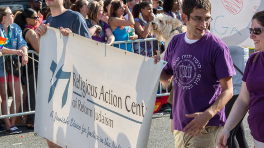 Representatives of the Religious Action Center of Reform Judaism march in a June 2014 gay pride parade in Washington, D.C. Credit: Tim Evanson via Wikimedia Commons.