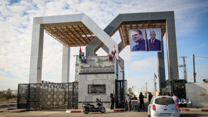 At right, photos of Egyptian President Abdel Fattah El-Sisi and Palestinian Authority (PA) President Mahmud Abbas hang at the Rafah border crossing between Egypt and the Gaza Strip on Nov. 1, 2017. While Hamas has given the PA administrative control of the Rafah checkpoint, the complete transfer of power in Gaza has been delayed from Dec. 1 to Dec. 10. Credit: Abed Rahim Khatib/Flash90.