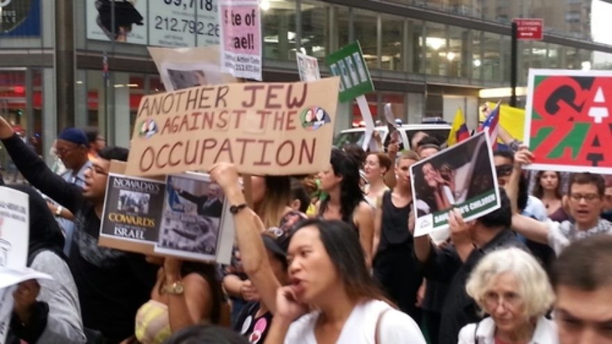 """An anti-Israel demonstration in Manhattan's Columbus Circle, including a Jewish anti-Zionist sign reading, """"Another Jew Against the Occupation."""" Credit: Ben Cohen."""