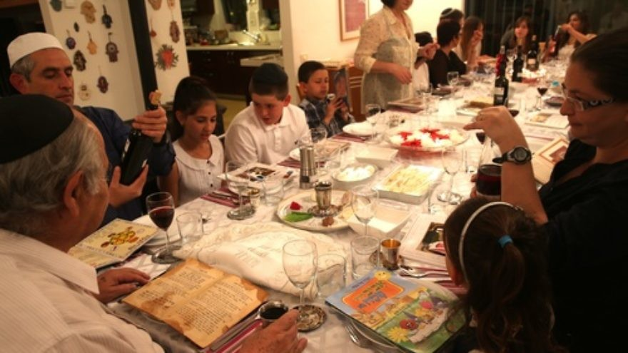 A family seen during the Passover seder on the first night of the holiday in Tzur Hadassah, Israel, on March 25, 2013. Diaspora Jews observe two seders each year, as opposed to one seder per year in Israel. Credit: Nati Shohat/Flash 90.