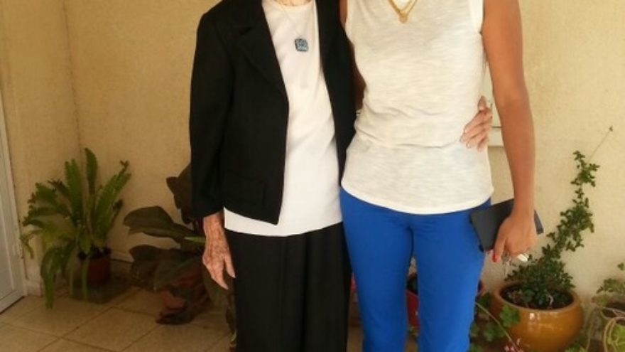 """Click photo to download. Caption:  Janet Tauro (right), a foreign worker from Mumbai, is the caretaker for Varda Kahanovich (left), a 90-year-old Israeli woman living on Kibbutz Maagan Michael. """"Today the foreign caregiver that lives with the patient—this is the most common way to grow old in Israel,"""" says Yaron Bengera, vice president of Yad Beyad, a Tel Aviv-based agency that recruits foreign workers. Credit: Provided photo."""