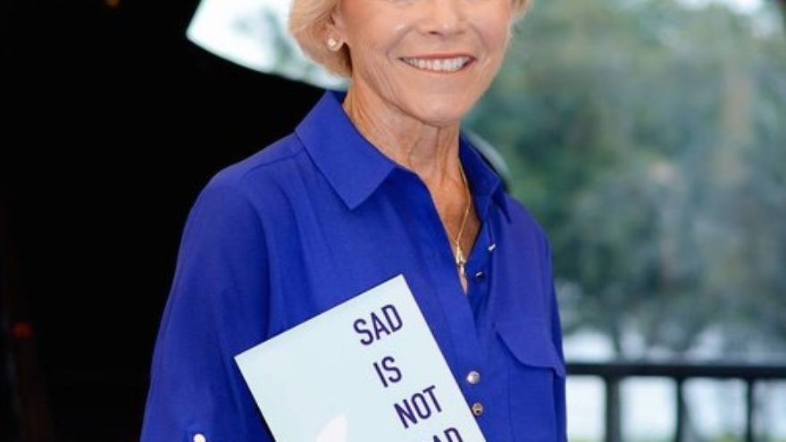 "Harriet Vogel with her book, ""Sad Is Not Bad: It's How We Grieve After We've Loved."" Vogel met her current love online at age 73—after grieving sufficiently to be open to someone new following the death of her husband. Credit: Courtesy of Harriet Vogel."