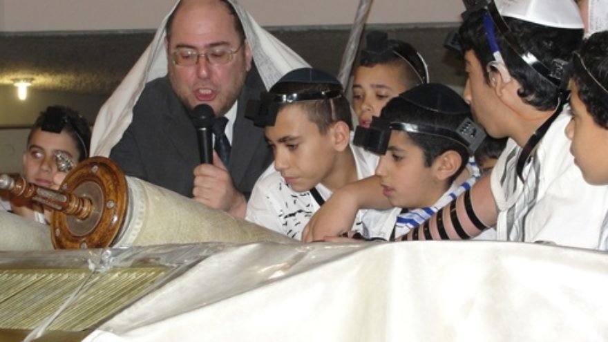 Caption: Rabbi Chanoch Yeres, director of the Deaf Programming Division of International Young Israel Movement (IYIM), leads a 2013 bar mitzvah for 63 deaf and hard-of-hearing children. Credit: Judy Lash Balint.
