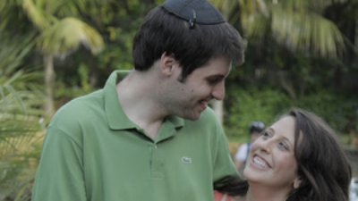 Click photo to download. Caption: Jacob Kamaras, the author of this column, with his wife Megan Marcus.
