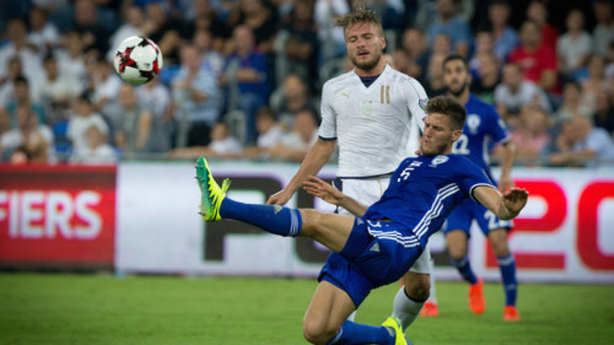 A FIFA World Cup qualifier match between Israel (blue uniform) and Italy at  the