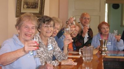 Click photo to download. Caption: Community members make a toast at the St. Louis NORC ( Naturally Occurring Retirement Community). A group of Jewish federations started NORC communities in response to a federal initiative to develop replicable models to deal with the coming increase in the senior population. Credit: St. Louis NORC.