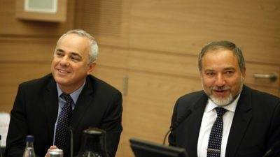 """Yuval Steinitz (left), Israeli Minister of International Relations and Strategic Affairs, and Avigdor Lieberman at a Foreign Affairs and Defence committee meeting in the Israeli Parliament in Jerusalem on May 20, 2013. Steinitz on Monday said  There is a """"real possibility"""" that Syrian President Bashar al-Assad """"could survive Syria's civil war and even prevail in it."""" Photo by Flash90."""
