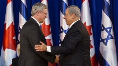 Israeli Prime Minister Benjamin Netanyahu shakes hands with Canadian Prime Minister Stephen Harper during a welcoming ceremony for Harper at Netanyahu's office in Jerusalem on Jan.19, 2014. Photo by Flash90.