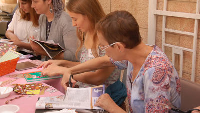 Click photo to download. Caption: A Tishkofet workshop for caregivers in Jerusalem. Credit: Courtesy of Tishkofet.