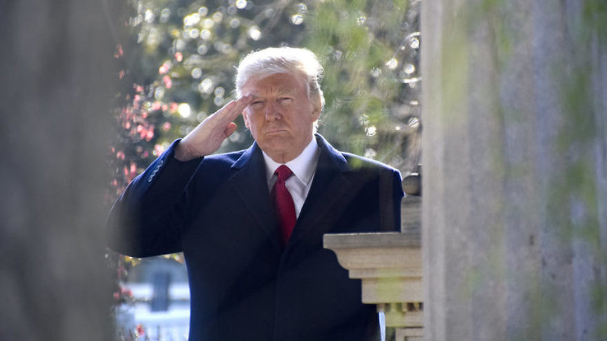 U.S. President Donald Trump salutes at the gravesite of former U.S. President Andrew Jackson. Credit: Tennessee National Guard Public Affairs Office via Wikimedia Commons.