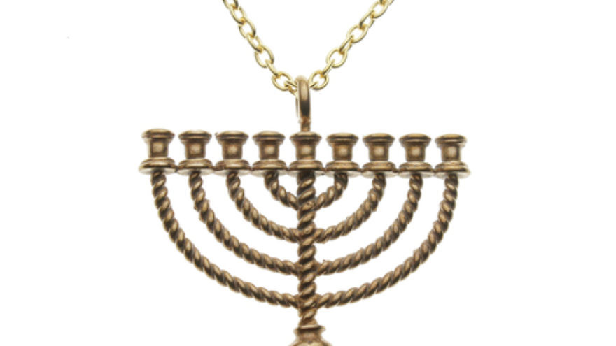 Click photo to download. Caption: A menorah necklace by From War into Peace, which uses recycled material from nukes for Jewish jewelry. Credit: From War into Peace.