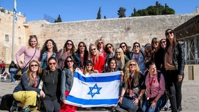"Participants of the Jewish Women's Renaissance Project's ""Media Magnets"" trip to Israel are pictured at the Western Wall in Jerusalem. Credit: Aviram Valdman."