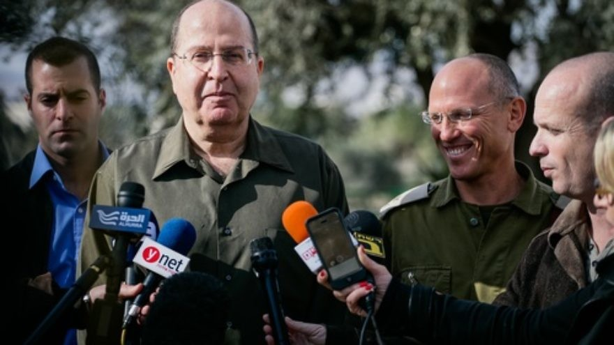 "Click photo to download. Caption: Israeli Defense Minister Moshe 'Boogie' Ya'alon gives a statement to the media during a visit to the IDF Central Command on Jan. 7, 2014. The Israeli newspaper Yedioth Ahronoth on Jan. 14 quoted Ya'alon as saying U.S. Secretary of State John Kerry's approach to Israeli-Palestinian conflict negotiations is an obsession"" and ""messianic,"" igniting a diplomatic stir. Credit: Flash90."