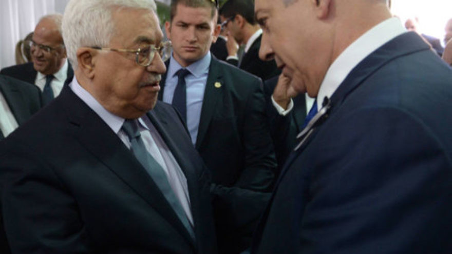 Israeli Prime Minister Benjamin Netanyahu meets with Palestinian President Mahmoud Abbas during the funeral of late Israeli President Shimon Peres, held at Mount Herzl, in Jerusalem Sept. 30, 2016. Credit: Amos Ben Gershom/GPO.