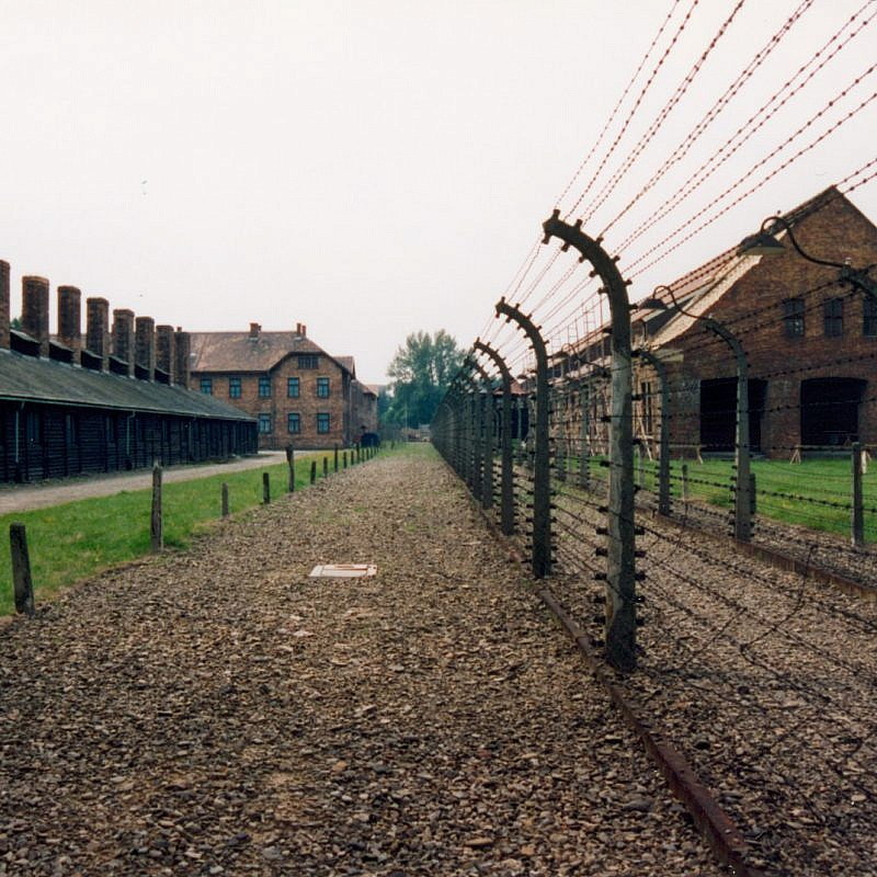 """The site of the former Auschwitz concentration camp in Poland. A controversial new law passed by Poland's parliament is rooted in Polish resentment when Auschwitz and other Nazi German concentration camps are referred to as """"Polish death camps."""" Credit: Giraud Patrick via Wikimedia Commons."""