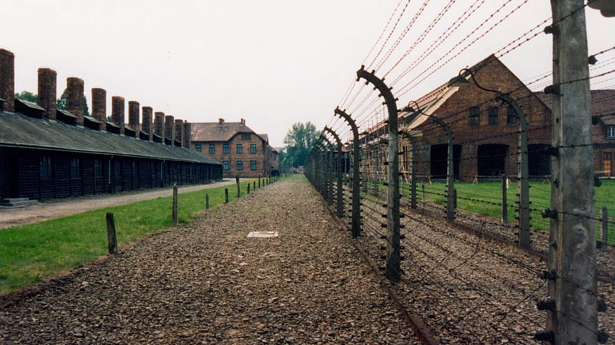 "The site of the former Auschwitz concentration camp in Poland. A controversial new law passed by Poland's parliament is rooted in Polish resentment when Auschwitz and other Nazi German concentration camps are referred to as ""Polish death camps."" Credit: Giraud Patrick via Wikimedia Commons."