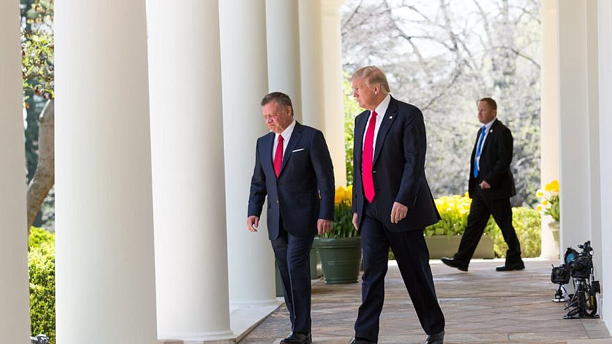 Jordan's King Abdullah (left) and U.S. President Donald Trump walk along the West Colonnade towards the podiums before a joint press briefing at the White House on April 5, 2017. Credit: White House/Shealah Craighead.
