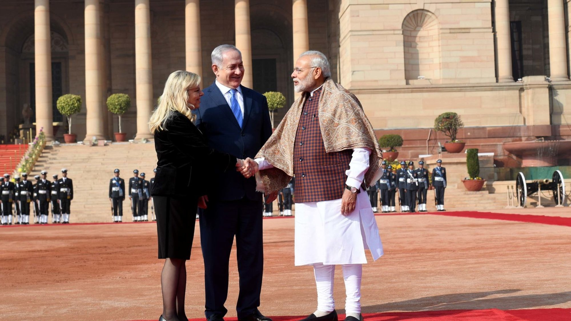Prime Minister Benjamin Netanyahu (center) and his wife Sara are welcomed by Indian Prime Minister Narendra Modi at the Presidential Palace in New Delhi. Credit: Avi Ohayon/GPO.