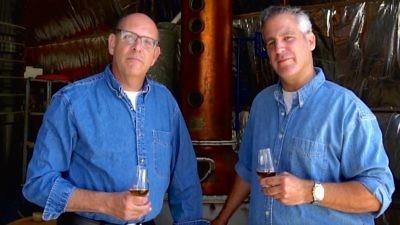 Legends Distillery founders Alan Cohl (left) and Noam Cohen in front of distilling equipment. Credit: Legends Distillery.