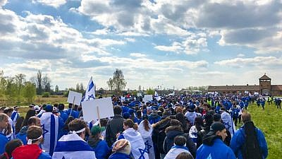 "Thousands of young people from around the world walk from Auschwitz to Birkenau, the sites of former Nazi death camps, during the 2017 ""March of the Living"" in Poland. Credit: Drew Jacobson via Facebook."