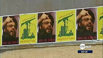 Posters of Hezbollah's flag and the terror group's leader, Hassan Nasrallah, in Beirut. Credit: Al Aan Arabic Television via Wikimedia Commons.