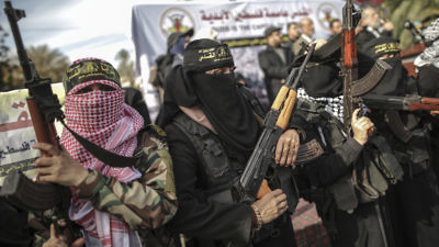 Armed female members of the militant Palestinian group Islamic Jihad take part in a rally to protest against US President Donald Trump's decision to recognise Jerusalem as the capital of Israel, in Gaza City on December 11, 2017.By Wissam Nassar/Flash90
