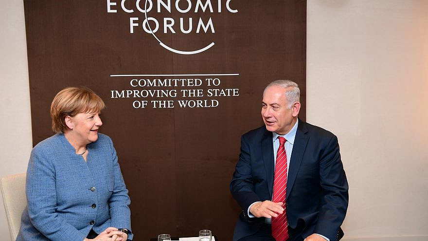 Israeli Prime Minister Benjamin Netanyahu and German Chancellor Angela Merkel meet at the World Economic Forum in Davos. Credit: Amos Ben-Gershom/GPO.
