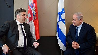 Israeli Prime Minister Benjamin Netanyahu and Croatian Prime Minister Andrej Plenković meet at the World Economic Forum in Davos, Switzerland, on Jan. 25 2018. Credit: Amos Ben-Gershom/GPO.
