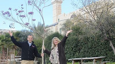 Rabbi Tuly Weisz, CEO of Israel365, and Donna Jollay, Israel365 Director of Christian Relations, plant a tree in the Jewish neighborhood of Hebron. Credit: Israel365