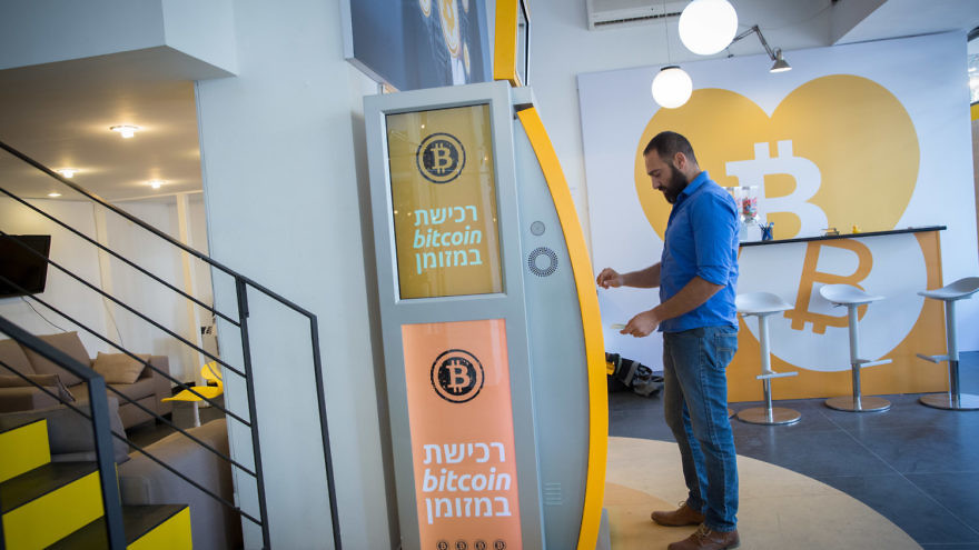 On Nov. 5, 2018, a man uses a bitcoin ATM machine at the Bitcoin Change center on Dizengoff Street in Tel Aviv. The center houses the ATM, as well as a museum on the history of the cryptocurrency. Credit: Miriam Alster/Flash90.