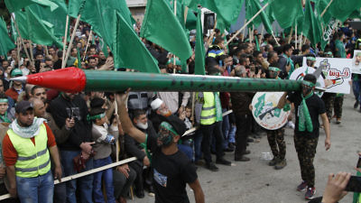 On Dec. 15, 2017, in the Palestinian Authority-controlled city of Nablus, Hamas supporters attend a rally marking the 30th anniversary of the terror group's founding. Credit: Nasser Ishtayeh/Flash90.