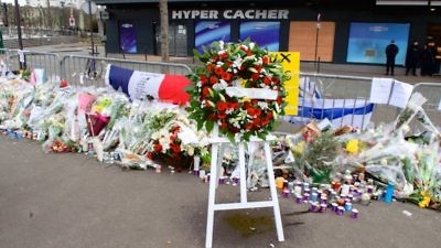 A wreath of flowers stands outside the Hyper Cacher kosher market in Paris on Jan. 16, 2015, a week after the Islamist terror attack there that killed four Jewish shoppers. Credit: U.S. Department of State.