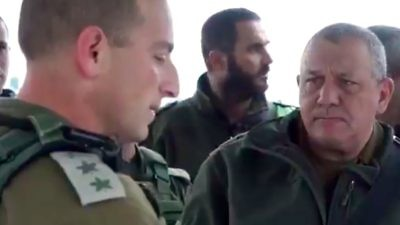 On Wednesday, IDF Chief of Staff Lt. Gen. Gadi Eisenkot (right) receives a briefing at the scene of the previous day's drive-by shooting terror attack in Samaria. Credit: IDF via Twitter.