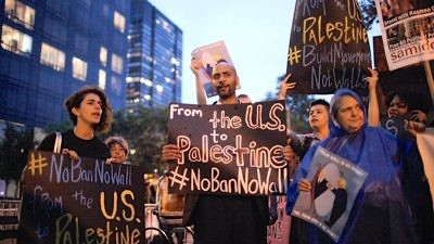 Protesters compare President Donald Trump's proposed U.S.-Mexico border wall to Israel's West Bank security fence at a Jewish Voice for Peace (JVP) demonstration in New York City last September. Credit: JVP via Facebook.