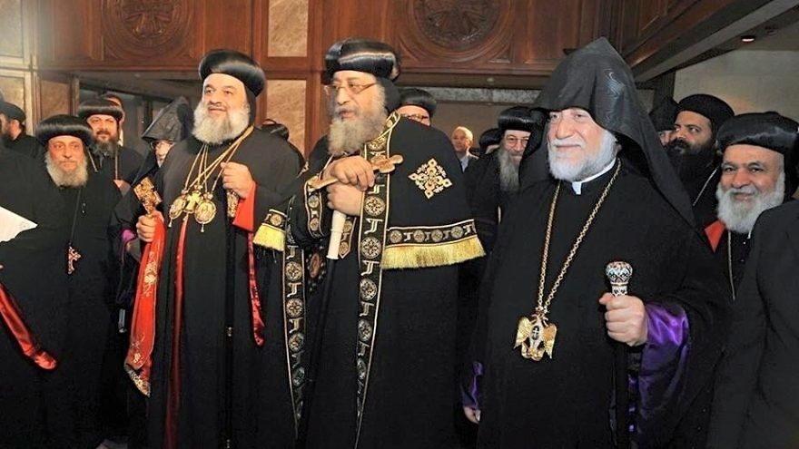In July 2016, Pope Tawadros II of Alexandria (pictured in front at center)—the leader of Egypt's Coptic Orthodox Church—hosts Ignatius Aphrem II (left), patriarch of Antioch and All East of the Syriac Orthodox Church, and Aram I, head of Lebanon's Catholicosate of the Great House of Cilicia of the Armenian Apostolic Church. Credit: Wikimedia Commons.